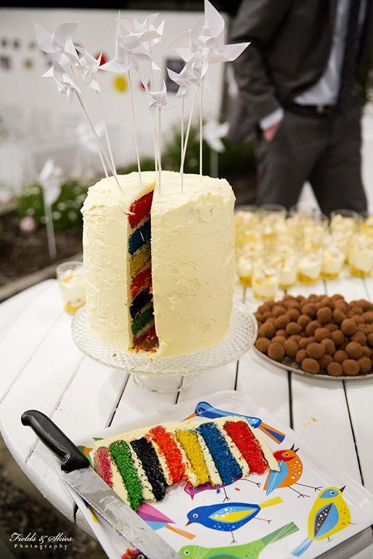 Rainbow wedding cake. Backyard wedding reception.  Fields + Skies Photography