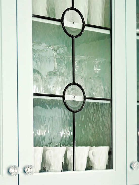 Leaded-Glass Cabinet Doors  Traditional leading with textured glass lends an old-world feel to your kitchen. Vintage-look glass door pulls add another layer of sparkle and shine.