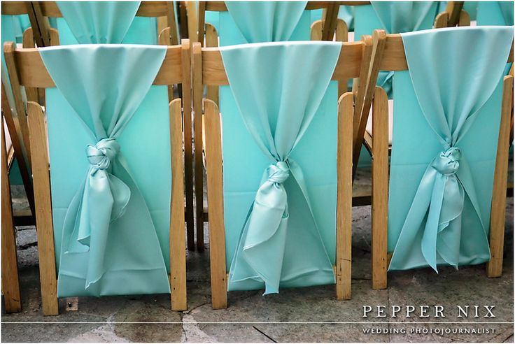 BEST IDEA EVER.  Using table runners instead of chair ties to make your ceremony pop with color and cover up regular folding chairs.  Table runners are about the exact same price as chair ties but give a lot more spread of color.  I wish every bride would use table runners instead of chair ties for her ceremony!!
