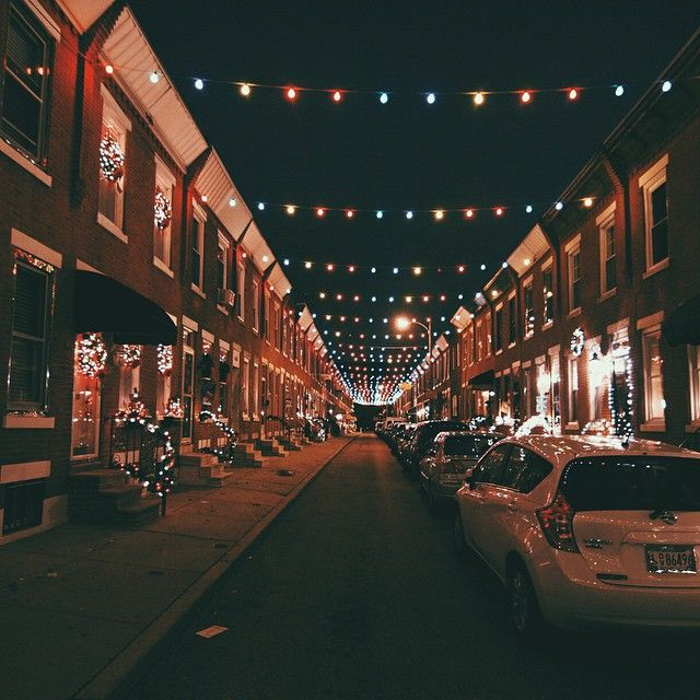 A small street in South Philly filled with holiday lights. (Photo by C. Benner for Visit Philadelphia)