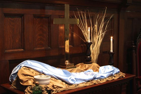 Rev. Sarah Weaver came up with the idea of using fabric to bring water through the desert  for her church's Ash Wednesday service, combining the waters of baptism with the imagery of the wilderness. Dried palms on one side, oil for anointing and ashes on the other.