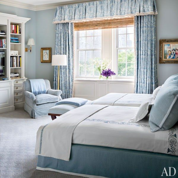 The room is painted in a Farrow & Ball blue, with curtains of a Brunschwig & Fils fabric | archdigest.com