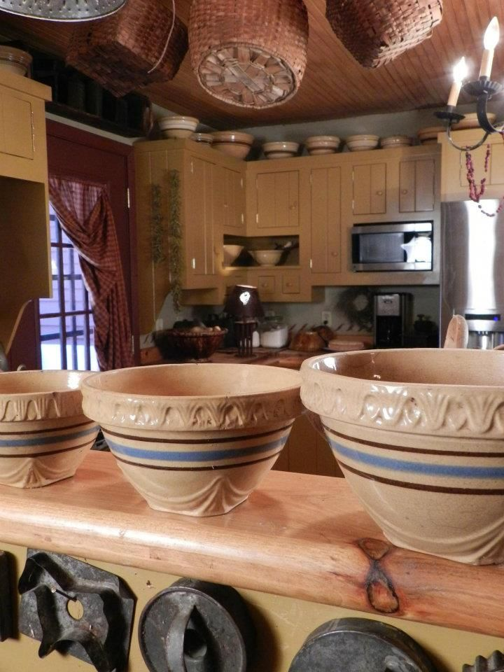 Prim Row...of old yellow ware & antique cookie molds.