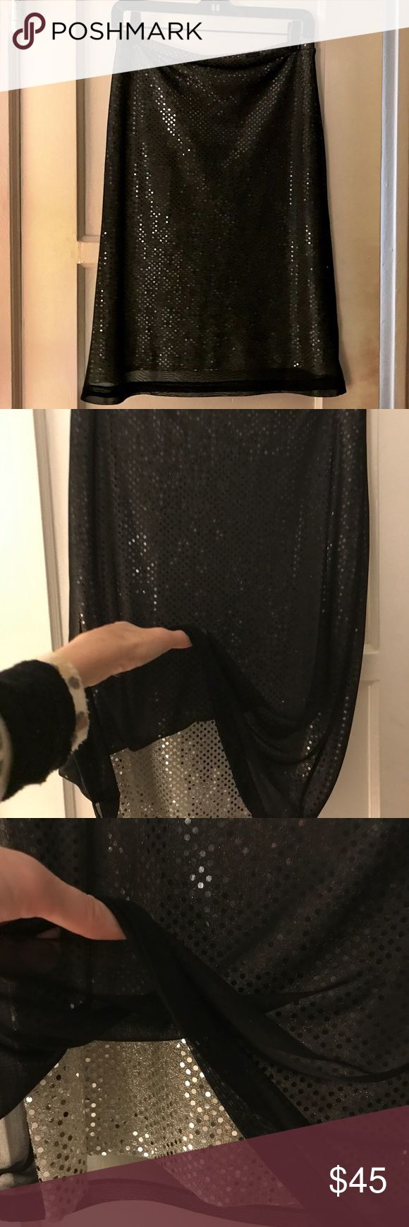 Express Sequin Pencil Skirt Gently Used.  Excellent Condition.   Double layered Pencil Skirt w a silver sequin layer under a sheer black layer to create a glamorous shimmering effect.   Comfortable with an elastic waist band.   Beautiful and flattering skirt that hits at the knee. Express Skirts Pencil