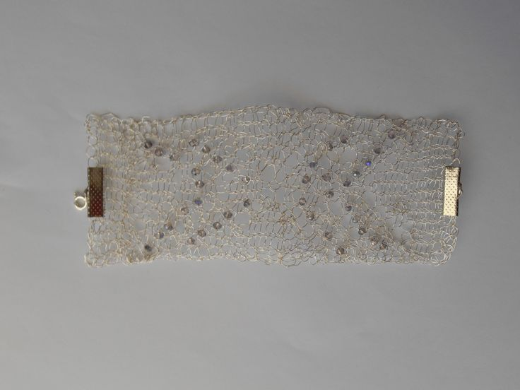 Knitted brachelet with silver plated wire and Swarofski crystals!!