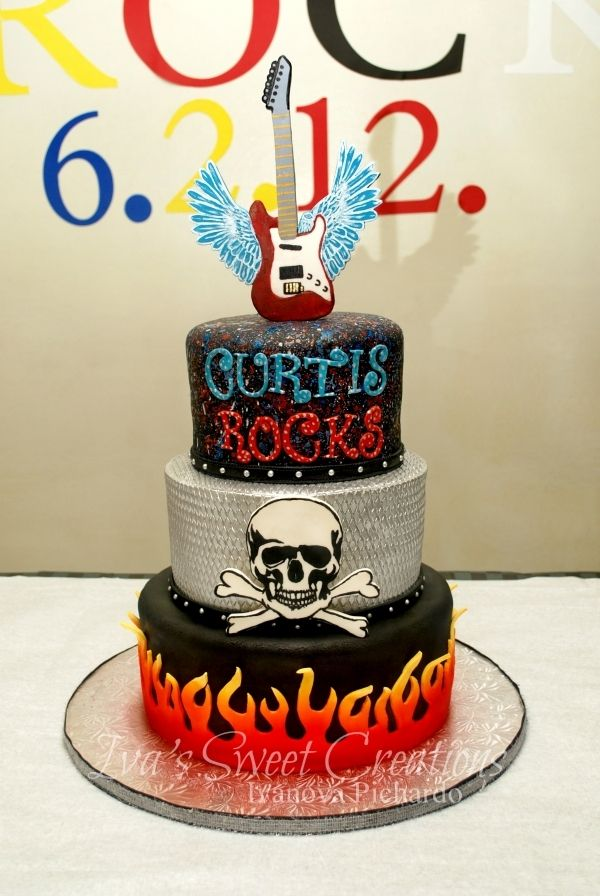 Rock Star birthday cake! Perfect! Studs around bottom of each layer instead of the belt looking things.