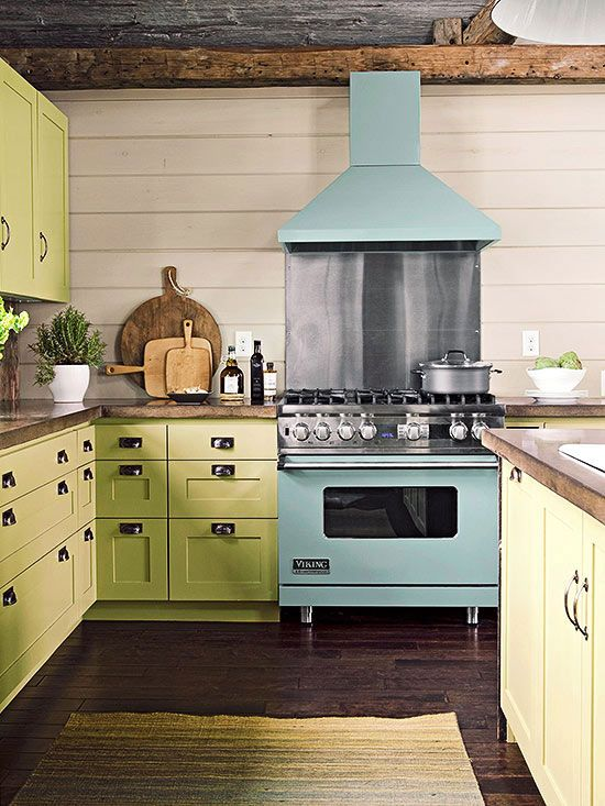 Celadon Cabinetry Pairs Playfully With An Aqua Enameled Range To Create  Casual Appeal In This Kitchen