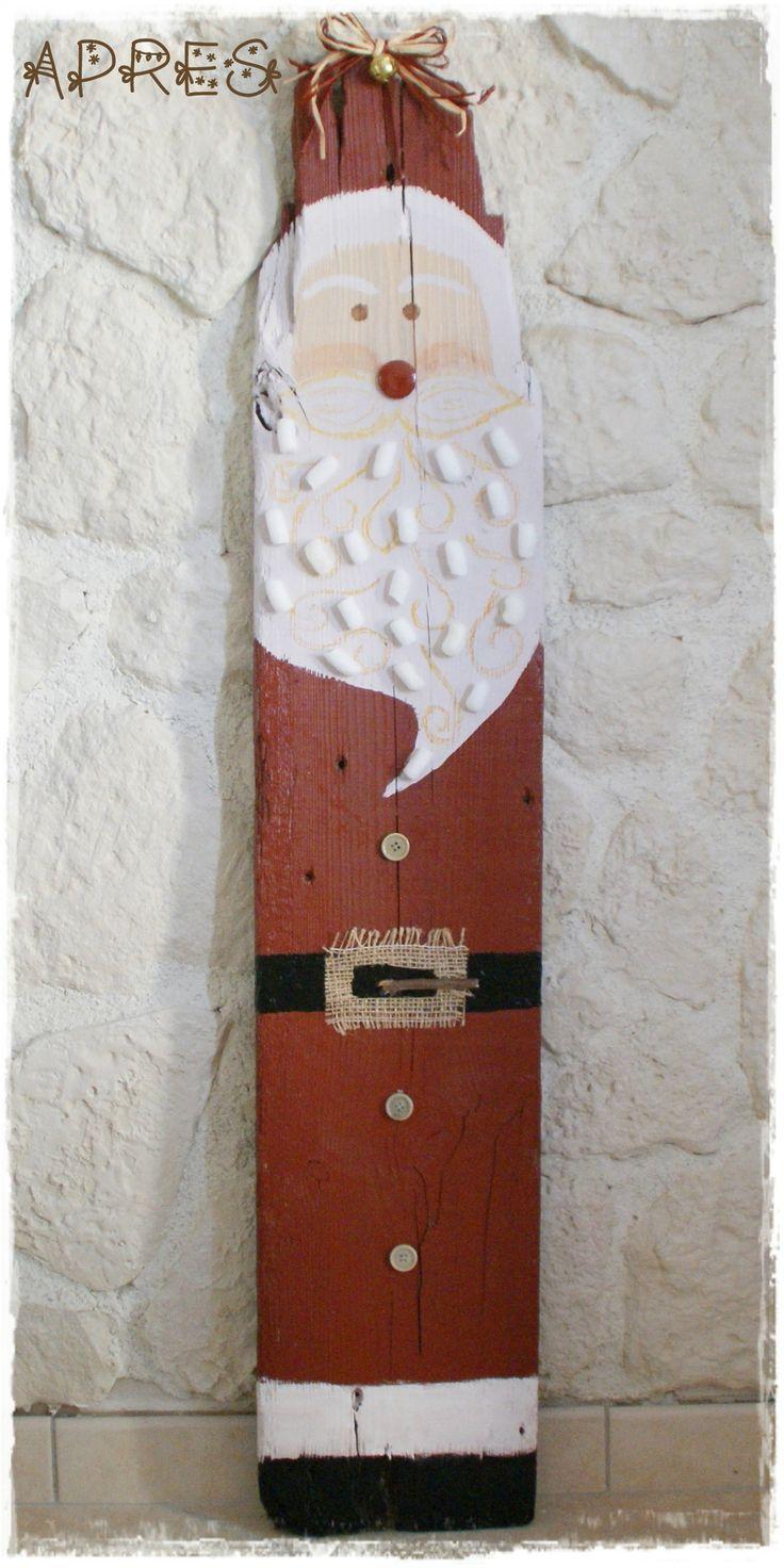 Père Noël avec une vieille planche