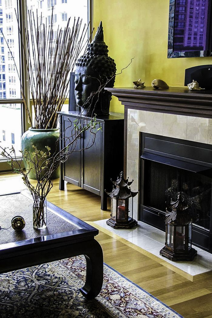 Dark colors and Asian flair in this room by cg creative interiors