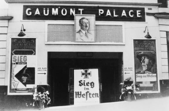 Guernsey: Frontage of the Gaumont Palace Cinema in St Peter Port adorned with Adolf Hitler's portrait and advertising a showing of 'Sieg im Westen' (Victory in the West).