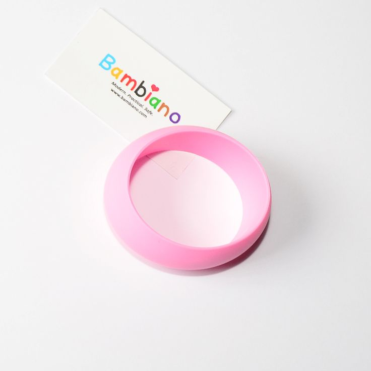 Bambiano Hoola Bangle in Baby Pink. Bambiano Bangles are made of 100% Food grade silicone. BPA free, Lead free and nontoxic. Fashionable for Mums and safe for teething babies to chew on. Bracelets are washable and soft on baby's gums. Shop at www.bambiano.com