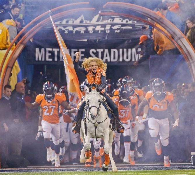 Thunder leads the Denver Broncos players onto the field. (Matt Slocum)