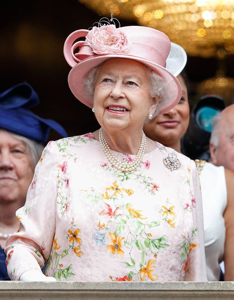 Queen Elizabeth II stands on the balcony of Liverpool Town Hall on June 22, 2016 in Liverpool, England.