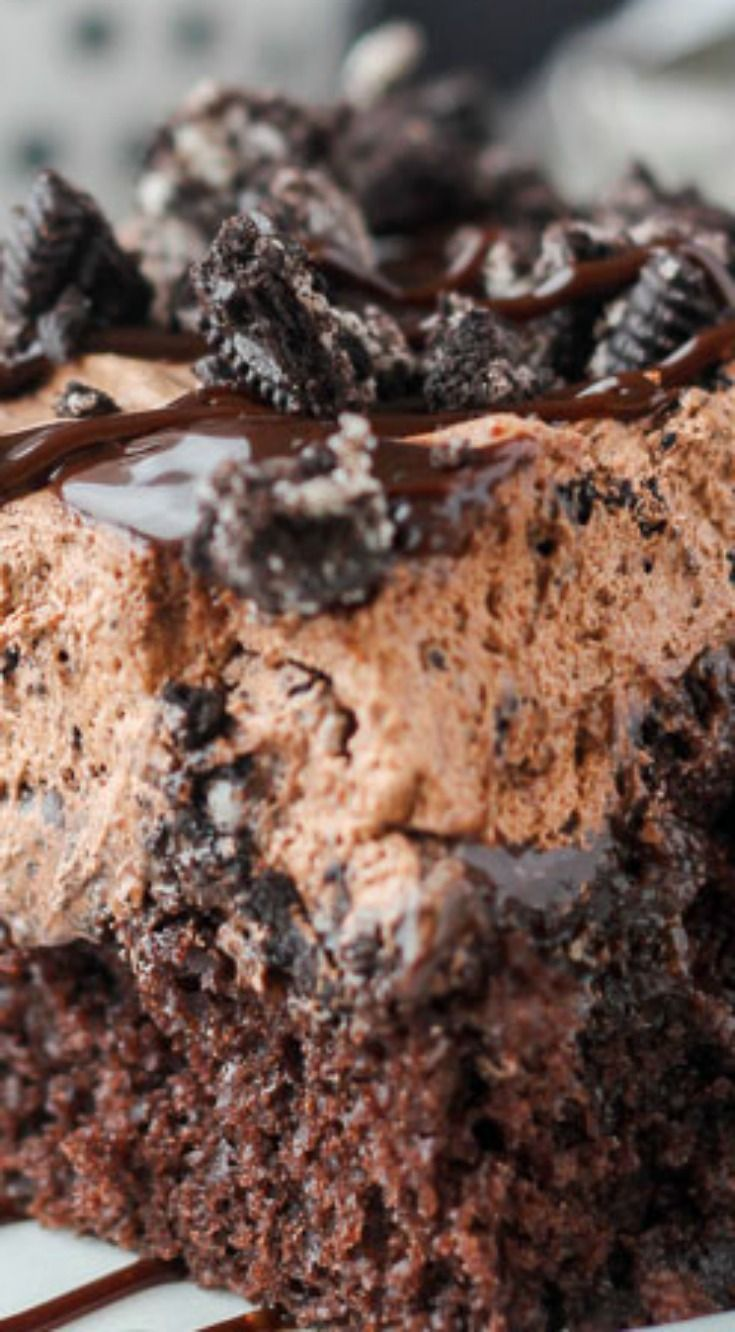 """Oreo Dirt Poke Cake ~ The chocolate cake is soaked in hot fudge and covered with a Chocolate Oreo Mousse also known as """"dirt""""."""