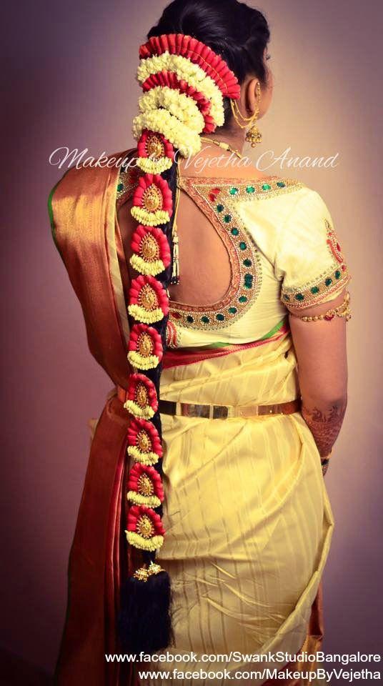 Traditional Southern Indian bride's bridal braid hair. Hairstyle by Vejetha for Swank Studio. Silk Saree. Sari Blouse Design. Hair Accessories. Gold jewelry. Jhumkis. Silk Kanjeevaram sari. Braid with fresh flowers. Tamil bride. Telugu bride. Kannada bride. Hindu bride. Malayalee bride. Find us at https://www.facebook.com/SwankStudioBangalore