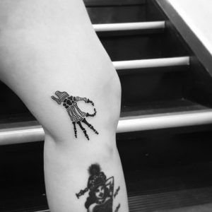 Skeleton hand tattoo by OK
