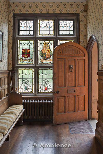 Tudor hallway - stained glass heraldic crest window - pointed arch door