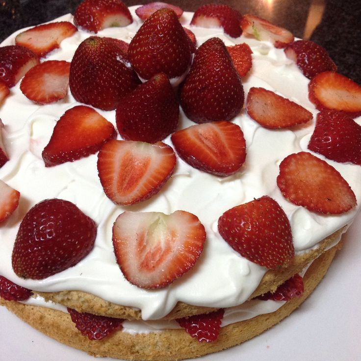 My 'naked' vanilla cake with strawberries and cream. A crowd pleaser.