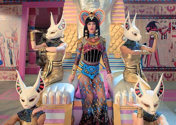 Katy Perry's Dark Horse. Katy's also Sophia Masterson in 'the Third Lover': http://www.amazon.com/dp/B00GZPVUOE