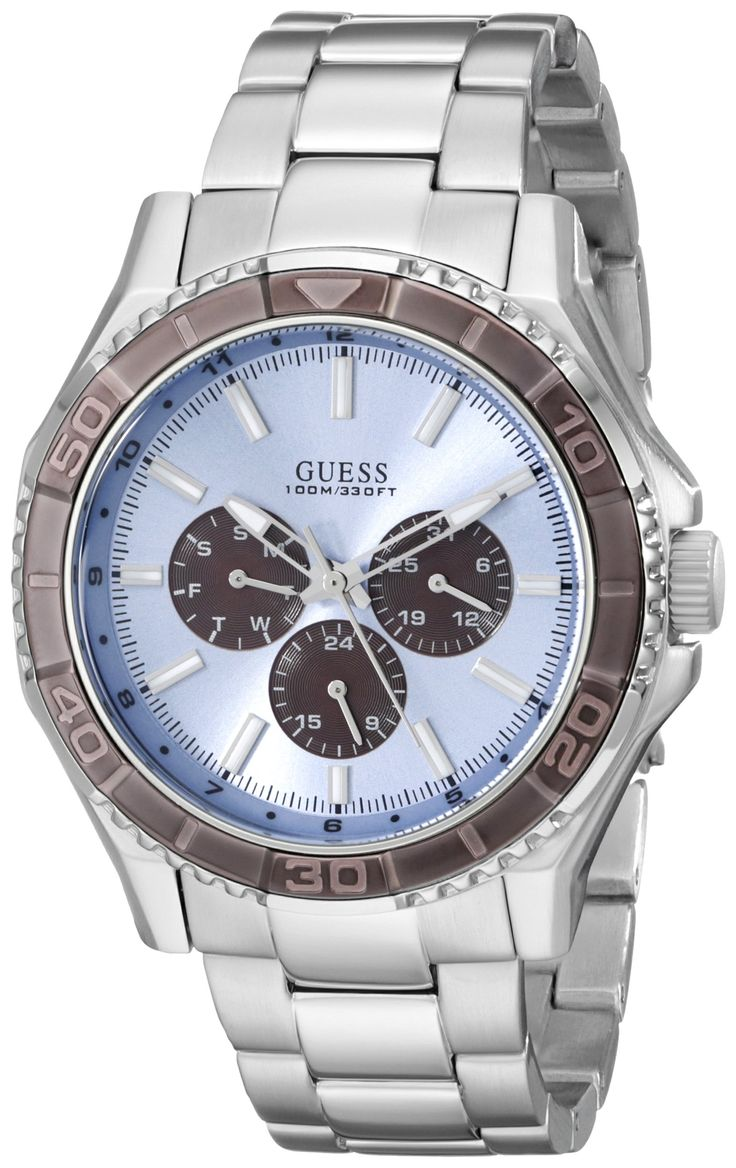 GUESS Men's U0479G2 Sporty Silver-Tone Stainless Steel Watch with Multi-function Dial and Silver-Tone Deployment Buckle. Watch featuring brown topring and ice-blue dial with day, date, and 24-hour subdials. 43 mm stainless steel case with mineral dial window. Quartz movement with analog display. Stainless steel link bracelet with deployant-clasp closure. Water resistant to 100 m (330 ft): In general, suitable for swimming and snorkeling, but not scuba diving. Define your time with a…