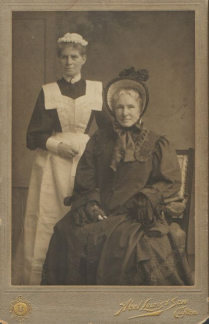 Wealthy woman and maid c. 1890