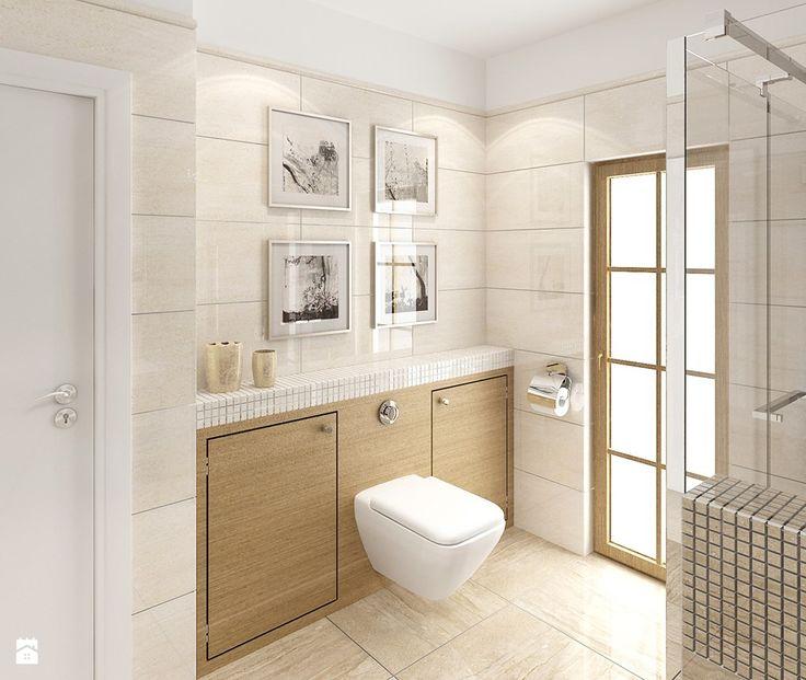 Jasne, polerowane płytki i duże lustro optycznie powiększyły łazienkę, a delikatne listwy wykańczające krawędź lustra i płytki od góry, dodają jej klasycznego charakteru.