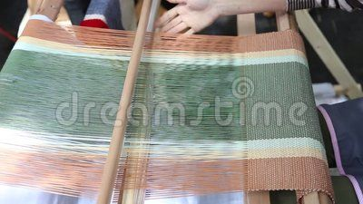 Artisan woman - working with traditional loom.