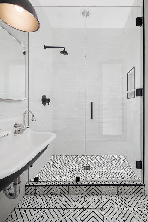 Black And White Geometric Floor Tiles Lead Past A Kohler Brockway Sink Fixed Under Restoration Hardware Bristol Flat Mirror Lit By Charcoal Gray