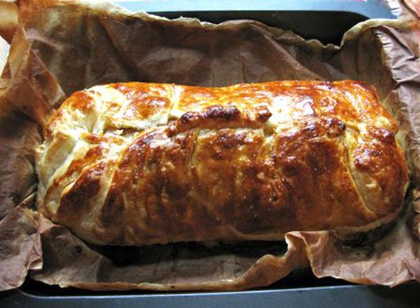 The Best Pork Tenderloin Recipe Ever! The Tenderloin is placed on  puff pasty covered with sauted onions & garlic, mustard of choice, cheese & ham . Then it is enclosed in the puff pastry. The result is very tender an juice.