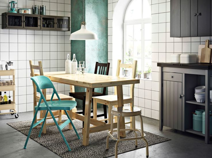 make a charming dining area by mixing a pineblack table with chairs in metal turquoise blackbrown and solid pine