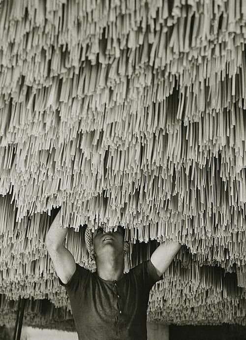 Spaghetti factory, 1932 Alfred Eisenstaedt. Job description: that would be early pasta maker
