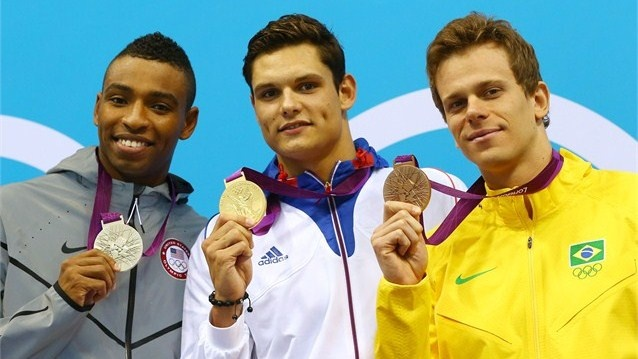 Silver medallist Cullen Jones of the United States, Gold medallist Florent Manaudou of France, and bronze medallist Cesar Cielo of Brazil pose on the podium during the medal ceremony for the men's 50m Freestyle Final on Day 7 of the London 2012 Olympic Games at the Aquatics Centre