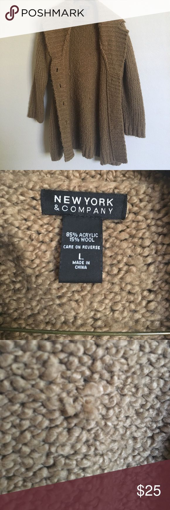 """New York & Co. long cardigan 15% wool so very warm • pretty thick knit • preloved so there is piling as well as some knots shown in pic 3 and 4, due to slight pull in fabric • no pockets • I'm 5'4"""" so the length of the cardigan hits me mid thigh • New York & Company Sweaters Cardigans"""