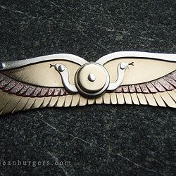 Multi-Layered Winged Disk Pendant