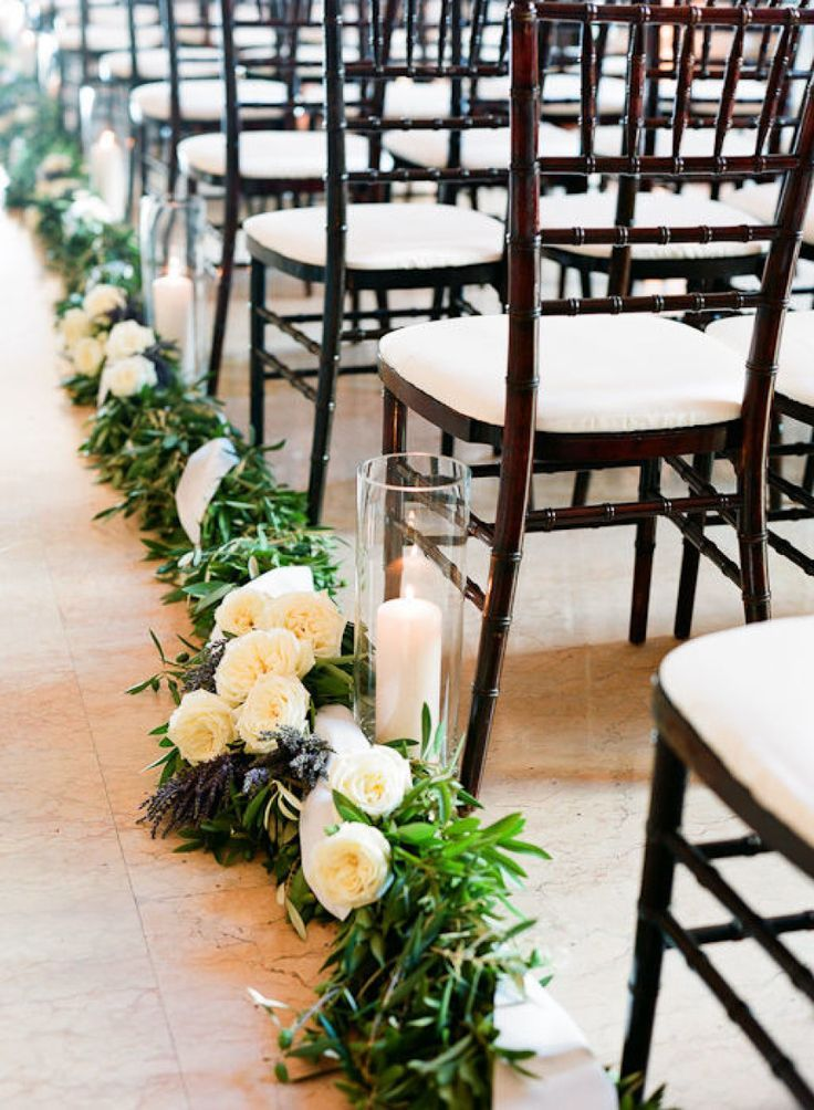 green and white winter wedding walk to the aisle