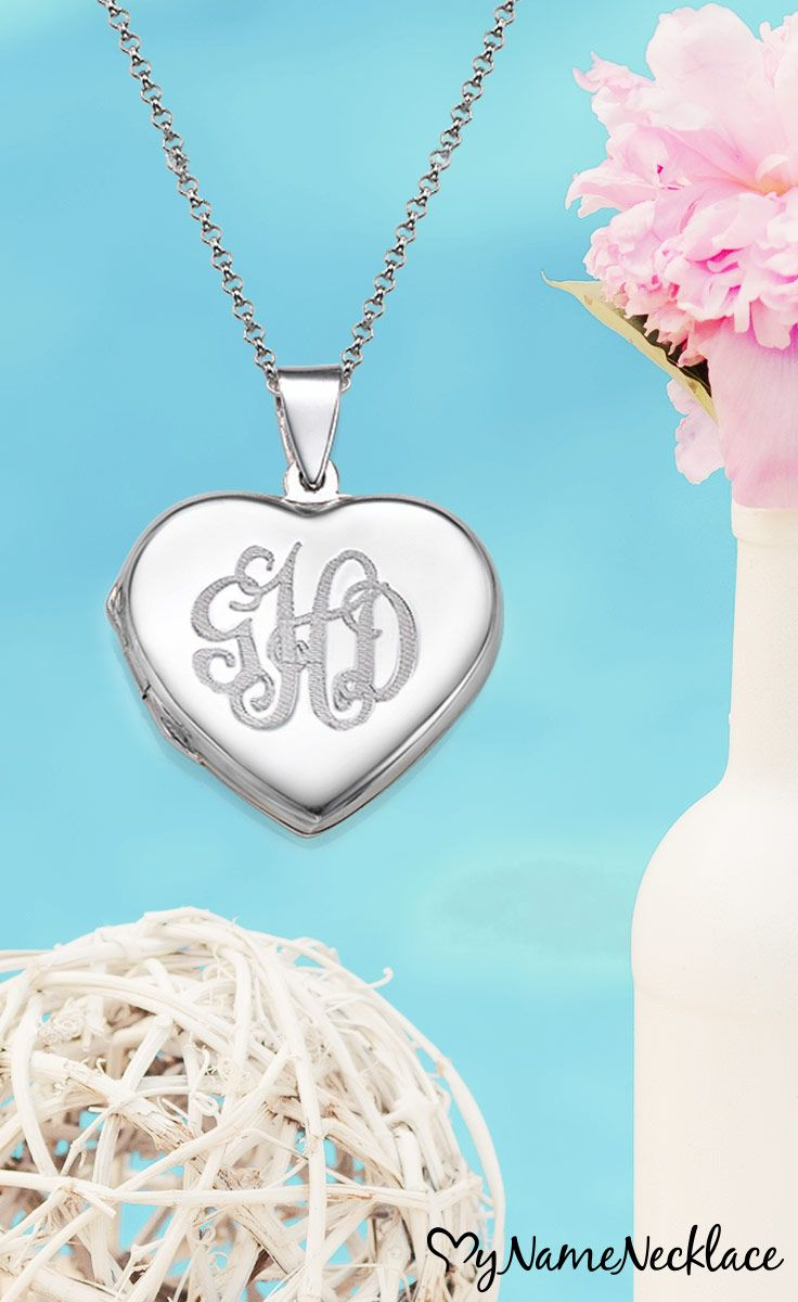 One of the best ways to keep those you love inside your heart is with the Sterling Silver Monogrammed Heart Locket Necklace! The heart necklace locket can be engraved with any monogram up to three initials long. Open the necklace to reveal the photos you would like inside. The perfect gift for loved ones on a wedding day, or to cherish special moments between you and the rest of your wedding party