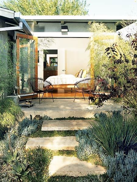 How peaceful does this look? French doors opening to a patio with fabulous landscaping.