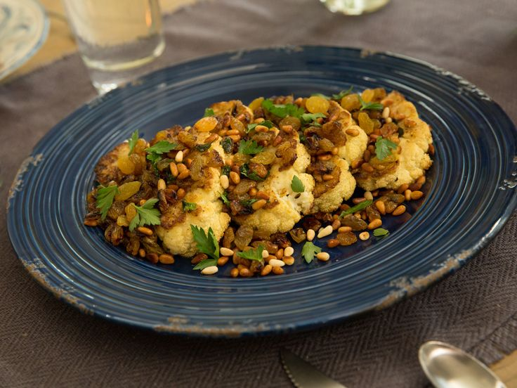 Roasted Cauliflower Steaks with Golden Raisins and Pine Nuts recipe from #ValerieBertinelli via #FoodNetwork #homecooking