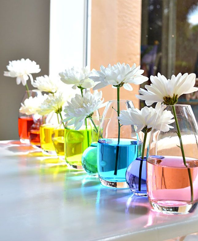Rainbow Water Centerpiece: How insanely creative is this DIY centerpiece? Just add a drop of food coloring to each glass vase to turn your water totally technicolor. You can even try color blocking every other vase, or go with an ombre fade from deep purple to light blue. (via Papery & Cakery)