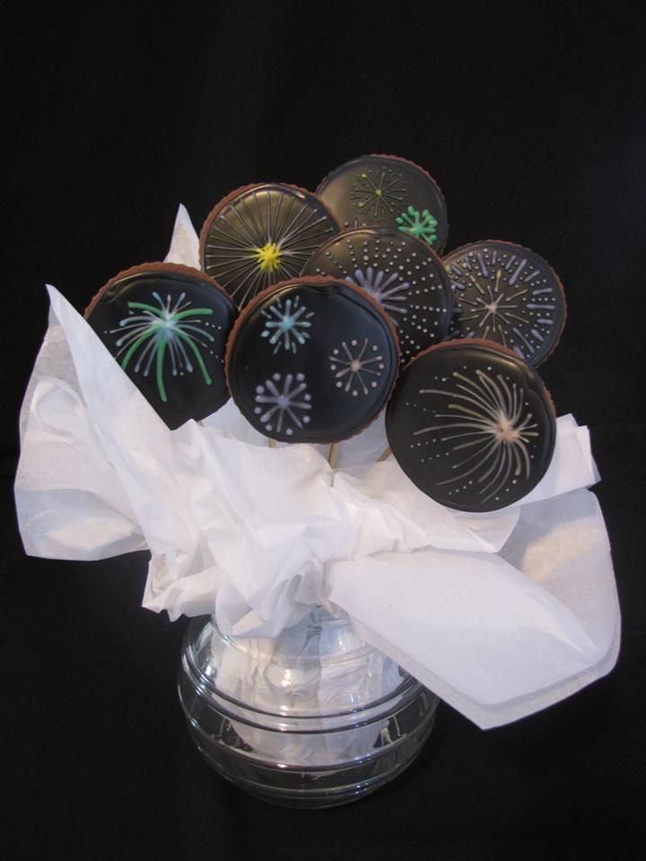 fireworks cookie pops. Could be done on oreos dipped in chocolate and decorated with royal icing