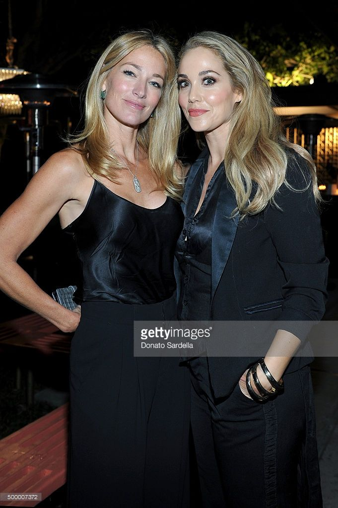Model Elaine Irwin (L) and actress Elizabeth Berkley attend a book party in honor of 'Becoming' by Cindy Crawford, hosted by Bill Guthy And Greg Renker, at Eric Buterbaugh Floral on December 4, 2015 in West Hollywood, California.