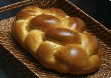 Shabbat blessings over candles, wine, and challah welcome in the Jewish Sabbath.