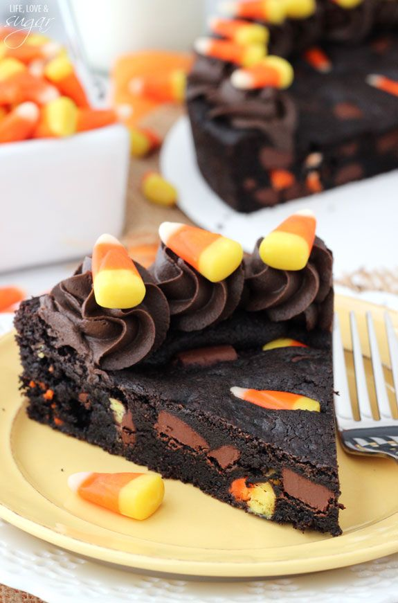 Candy Corn Chocolate Chip Cookie Cake - a moist, chewy cookie filled with chocolate chunks and candy corn! Perfect for #Halloween!