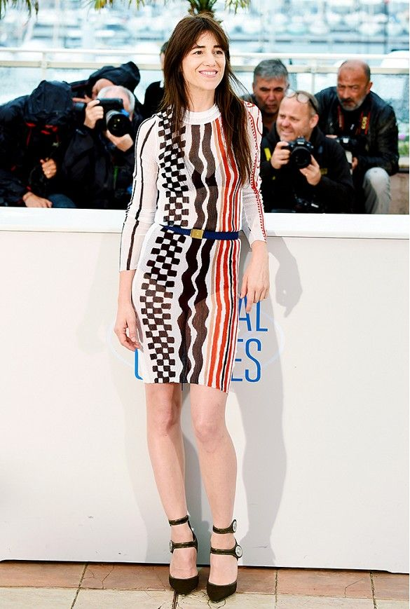 Charlotte Gainsbourg wears a belted printed dress with black buckle pumps