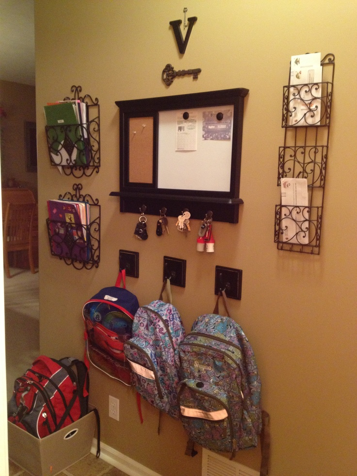 Entry organization ... like the basket/bin for the backpacks on the floor ... need to do this for the pantry.