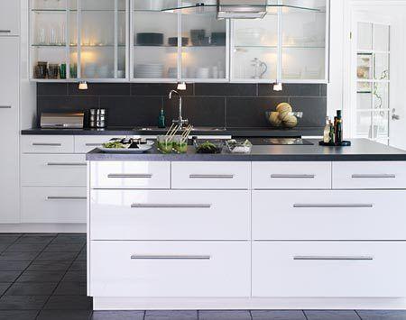 """Cabinets: ABSTRAKT White $3326.00    Appliances: Cooktop Eldig Glass 30"""" $429.00, Oven Mumsig 24"""" $699, DW Renlig $499.00, Hood Luftig HOO S50 $1299.00    Countertop: NUMERAR Gray/Aluminum Laminate $276.00    Backsplash: Porcelan tile $168.00    Sink: IKEA BOHOLMEN 2 bowl $99.00    Faucet: IKEA ALSVIK $129.00    Under cabinets light: $36.00    Handles: IKEA LANSA $63.00    Total: $6867.00"""