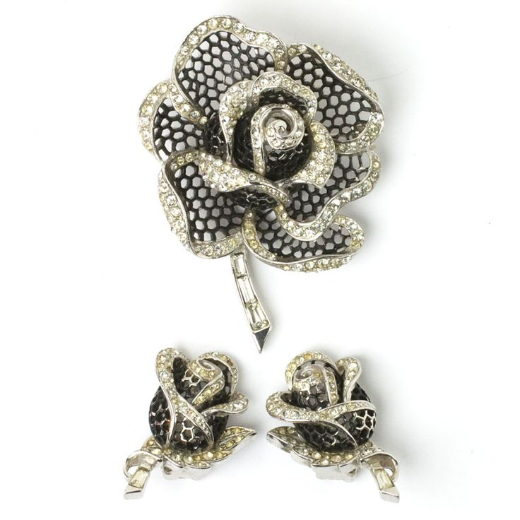 """This elegant and highly-detailed 1950s """"Rose of Seville"""" brooch and earrings set by Marcel Boucher is embellished with black enamel and diamanté."""