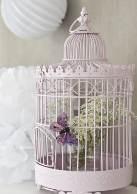 There is something special about adding a bird cage into the decor mix of a room – it's like informal bohemian vibe, the Victorian feel, kind of steampunk touch. Here are some ideas to use a bird cage for décor. For lighting. House candles or stuff a bird cage with a strand of string lights....