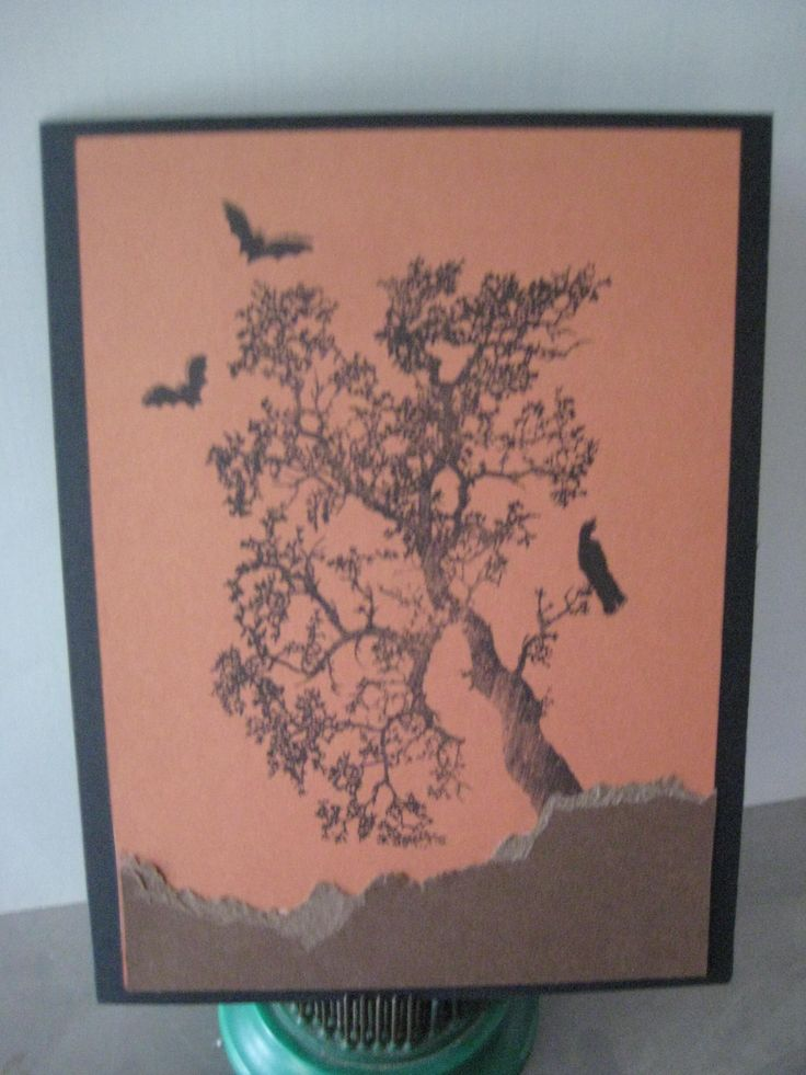 ravens in a winter tree, black on brown Halloween card with bats and raven