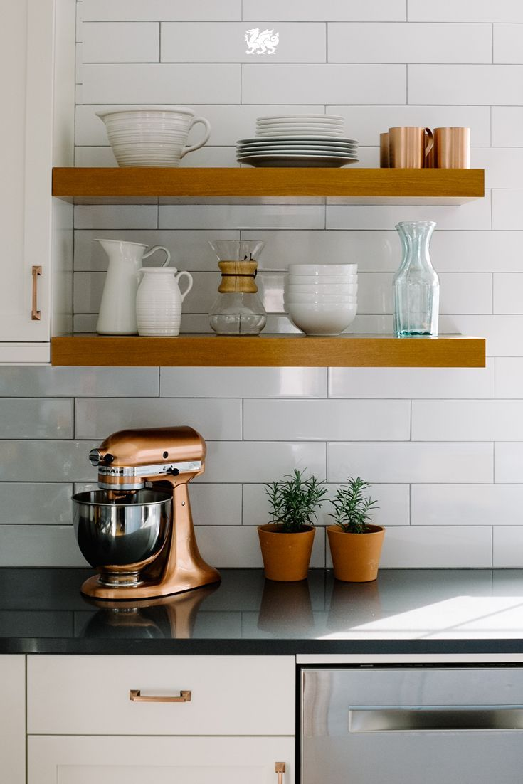 Love open shelving but not sure how to make it work for your kitchen? One of the easiest ways to keep the look in line is by displaying only those items you truly love. Odds are, you use them so often already that a door-less shelf makes them that much more convenient. {wineglasswriter.com/}
